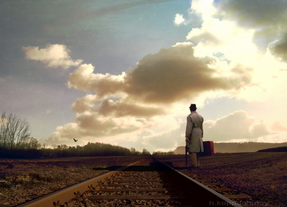 man with briefcase at train tracks