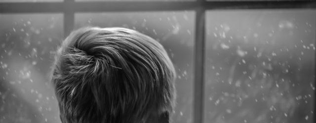 Boy looking outside at Santa