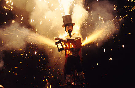 A model of Guy Fawkes engulfed in flames and sparks